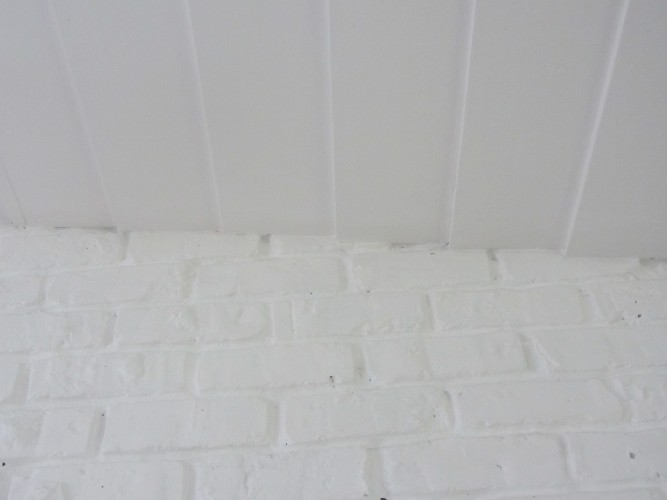 ceiling and white brick