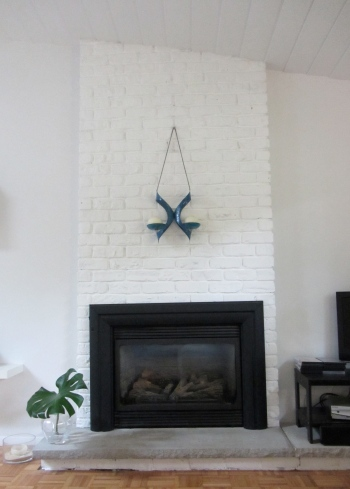 Hanova of Pasedena Enamel Candle Holder above fireplace