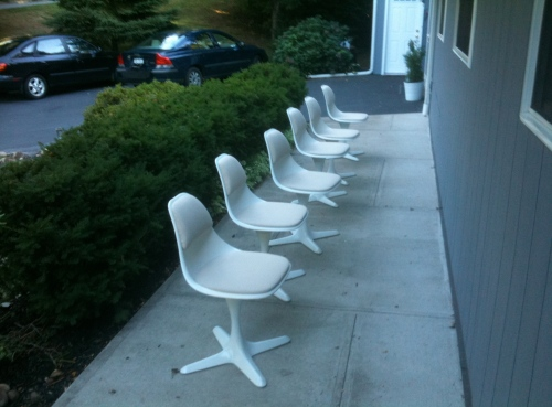 Burke Inc chairs four star base on walkway