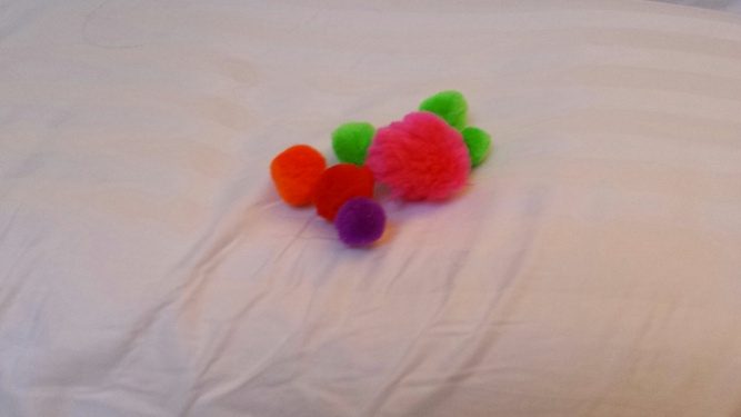 pom poms on pillow